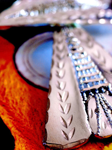 Prajapati: Triangular- sterling-silver-earrings, close up of rope-work and etched leaves on solid outer edges