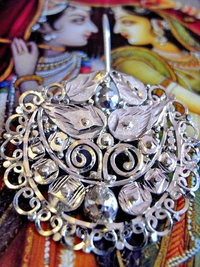 Radha earrings: sterling-silver; close-up of filigree, facets and etching