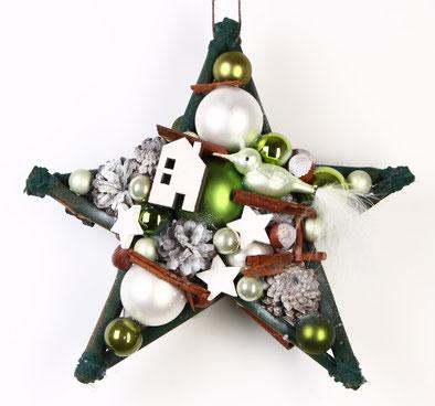 Grün-weißer Stern mit Vogel und Häuschen