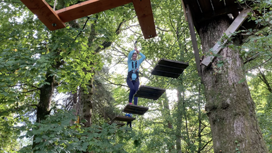 Susanne McCabe traverses an obstacle on the treetop course in Loch Lomond.
