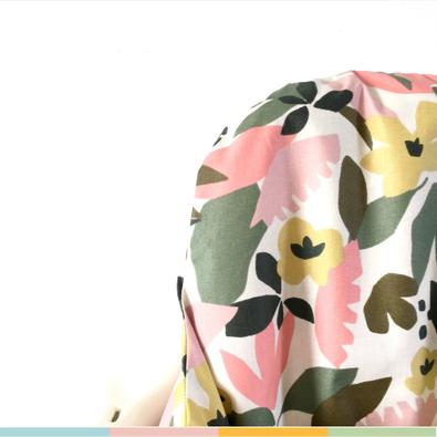 cette image représente la housse de chaise haute modèle Brenda en coton enduit.