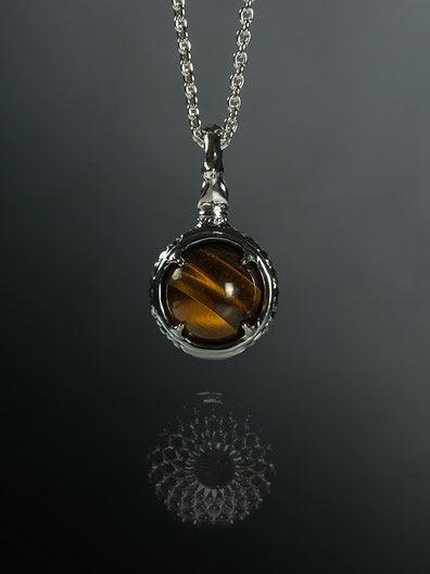 A dragon's jewel NUBUSHI-TAMA that prays at Okinawa's Utaki. Tiger eye Power Stone Pendant Necklace