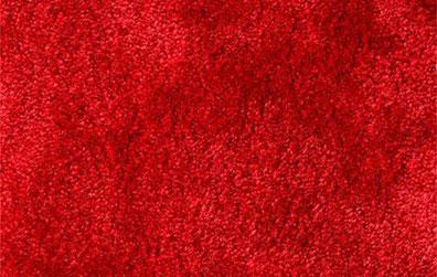 Alfombra de pelo corto color rojo caoba