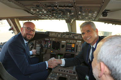 Charles Michel (pictured left) at the controls