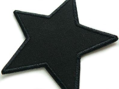 Bild: schwarzer Stern Bügelflicken aus robustem Canvas als Flicken zum nachhaltigen Reparieren von Hosenlöchern