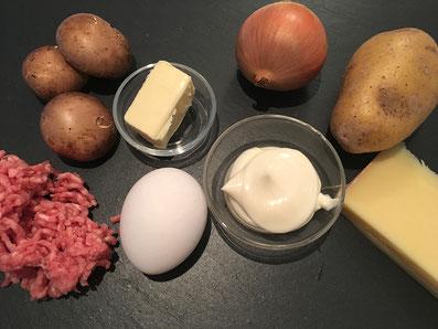 Zutaten: Gehacktes Fleisch, Kartoffel, Ei, Mayonnaise, Zwiebel, Champignon, Käse, Butter