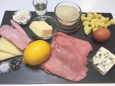 Zutaten: Kalbsschnitzel, Käse, Schinken, Mehl, Ei, Paniermehl, Butter, Zitrone