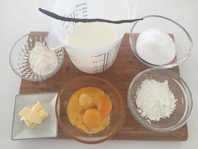 Zutaten: Milch, Zucker, Mehl, Stärke, Vanilleschote, Eigelb, Butter