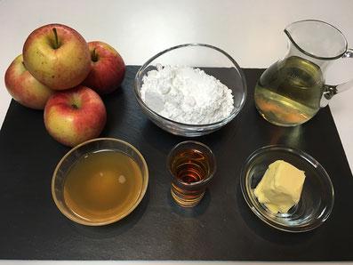 Zutaten: Äpfel, Puderzucker, Weisswein, Apfelsaft, Rum, Butter