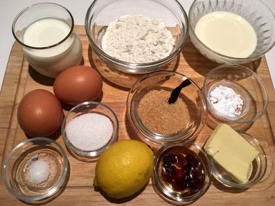 Zutaten: Milch, Mehl, Eier, Zucker, Rahm, Salz, Zitronenzesten, Vanillemark, Butter, Rohzucker, Sultaninen, Puderzucker, Zwetschgenkompott