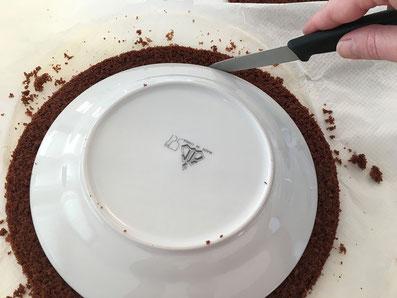 Auf die zweite Scheibe den Teller legen