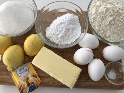 Zutaten: Butter, Mehl, Eier, Zitronen, Backpulver, Salz, Zitronensaft, Puderzucker