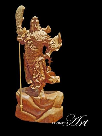 Guan Gong holding his Guan Dao