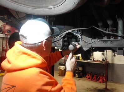 auto repair technician rebuilding a 2009 Nissan Titan differential