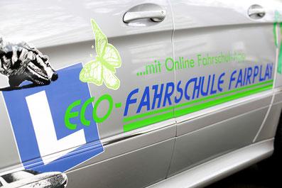 graues ECO-Fahrschule Fairplay Auto inklusive Logo
