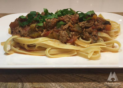 Fettuccine bolognese with porcini powder