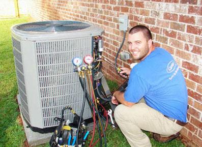 Speir technician repairing air conditioner