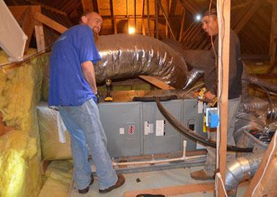 Speir technicians repairing a furnace