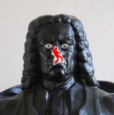 Dieses Bild zeigt Elvis, wie er mit Hüftschwung auf der Nase von Johan Sebastian Bach herumtanzt.