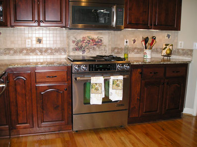 Stone Impressions kitchen backsplash with fruit still life mural and drops