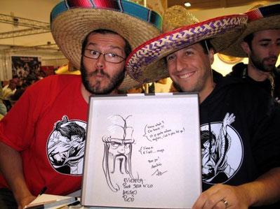 (A.Bauza en compagnie de l'illustrateur Pierô, tous deux coiffés du traditionnel sombrero de l'éditeur Repos Prod) / crédit photo : www.jeuxnco.org