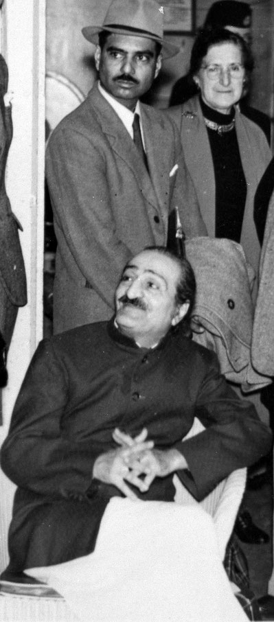 1956 : Meher Baba with Eruch Jessawala standing behind him with Ann at London Airport beofre departing for the USA.