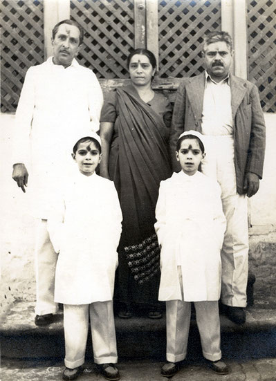 Baba House in Poona in the early 1950's. Standing back from left at Beheram and Perin Irani & twins. Uknown man on far right.