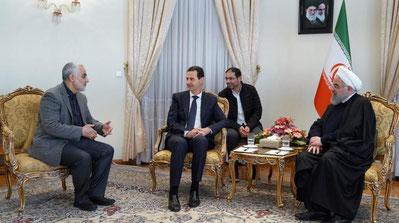 Qassem Soleimani, med Syriens Bashar Assad og Irans præsident  Hassan Rouhani