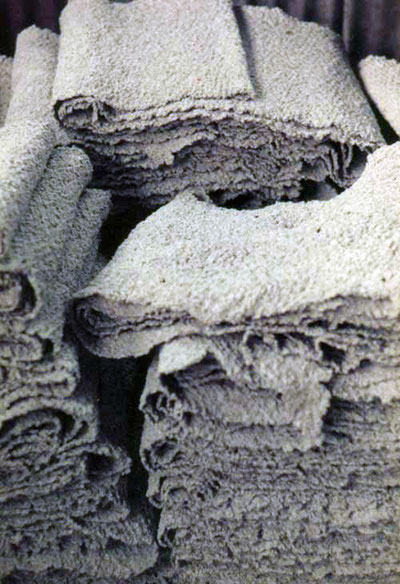 Processing latex: Low Quality Wet Colagulum Crepe Blanket (Courtesy Mitchel P. (ecoport) WikiCommons