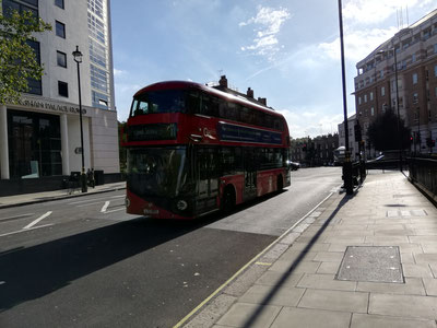 Double deck coach (characteristic for London), blue sky (not even)