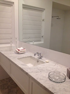 Treated Carrara marble bench top, silver lever mixer with large soft touch drawers
