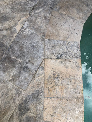 Travertine outdoor tiling around pool & pathways