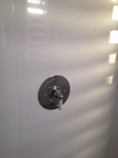 Circular single porcelain lever shower mixer from the UK