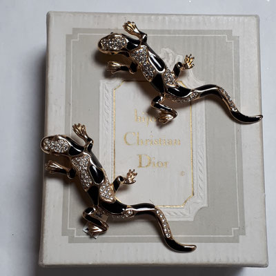 ONE of these two Christian Dior salamander brooches, black on gold, signed. €260