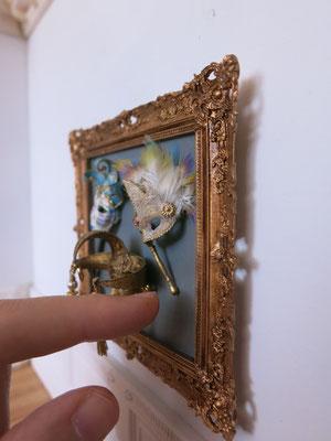 Frame with venetian masks