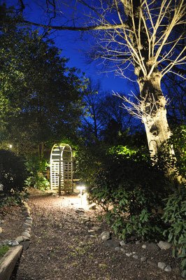 This resort-like, multilevel backyard with winding paths and a streaming brook cutting across it...was the ideal canvas for a lighting designer to extend the use of this amazing yard into the evening hours. Montvale, NJ