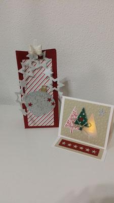 Weihnachtskarte mit Licht und Weihnachtsverpackung