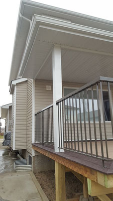 Covered deck roof addition guard railing