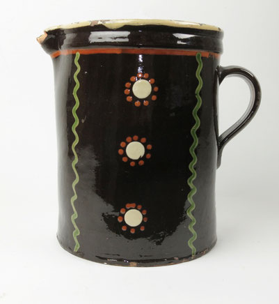 Folk art, very large brown glazed slip decorated jug