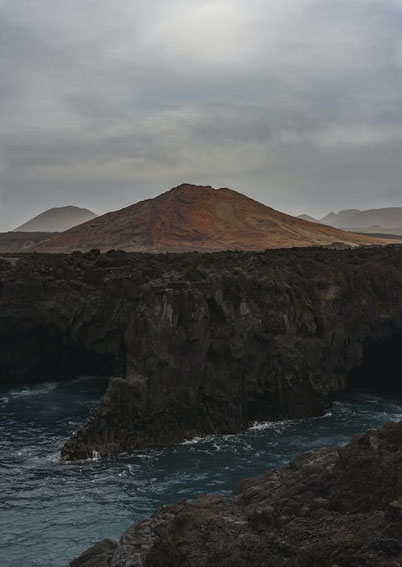 volcanic cliffs in Lanzarote and volcanos