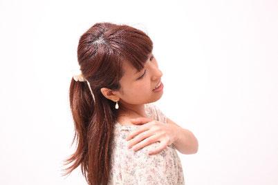 背中の痛い奈良県香芝市の女性