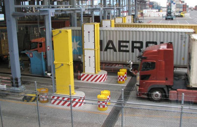 Trucks driving through Radiation Monitoring Portals