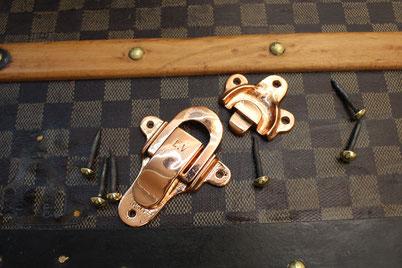 Louis Vuitton clasp in copper