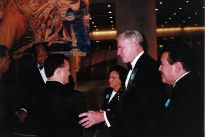 "George Yepes with Charlton Heston, and Mayor Tom Bradley, at the unveiling of ""The Angel of Hope"" at the Los Angeles Convention Center."