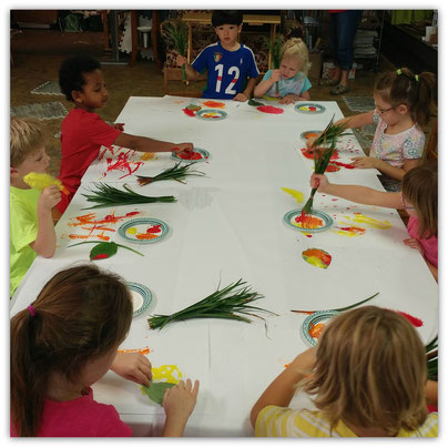 A Preschool Class Using Nature Paint Brushes