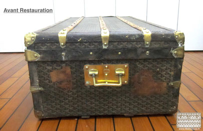 Damaged goyard trunk, stained leather. brass handle