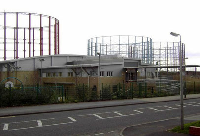 Windsor Street Gas Works - gasometers off Avenue Road. The building in the foreground is Nechells Sports Centre in Rupert Street c2000.