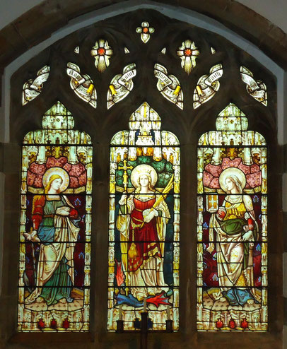 Stained glass window of St Margaret flanked by Hope and Faith
