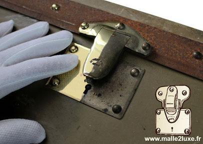 Moynat automobile trunk brass lock detail