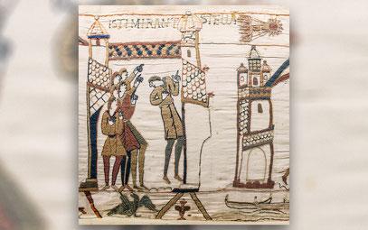 Ein Ausschnitt vom 68 Meter langen Teppich von Bayeux, auf dem der Halleysche Komet bei seiner Sichtung  im Jahre 1066 dargestellt sein soll.